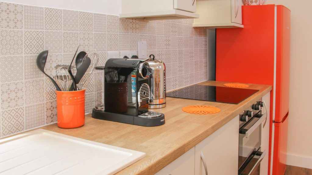 Kitchen with orange fridge