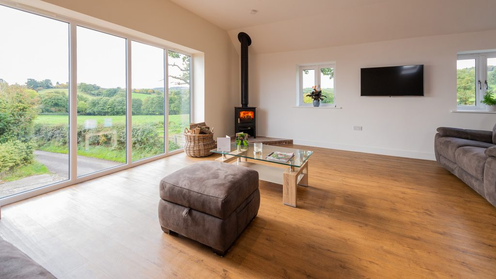 Log burner and picture window in sofa area