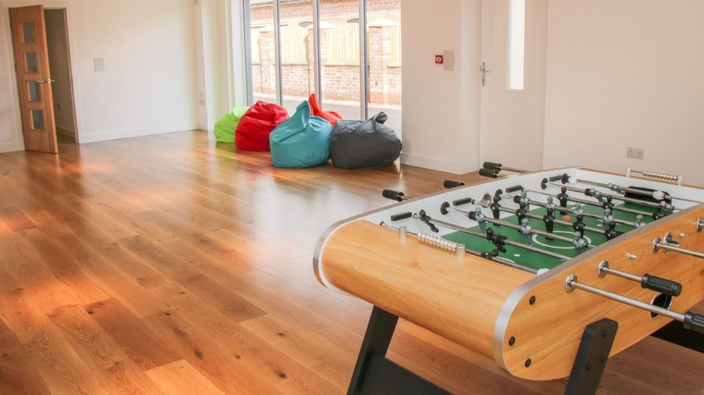 group accommodation football table and bean bags